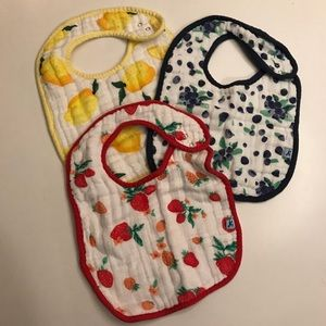 Little Unicorn bib set. Never used. Fruit print.
